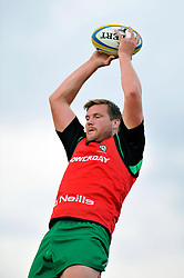 Nic Rouse (London Irish) wins the ball at a lineout during the pre-match warm-up  - Photo mandatory by-line: Patrick Khachfe/JMP - Mobile: 07966 386802 22/08/2014 - SPORT - RUGBY UNION - Middlesex - Hazelwood - London Irish v Bristol Rugby - Pre-Season Friendly