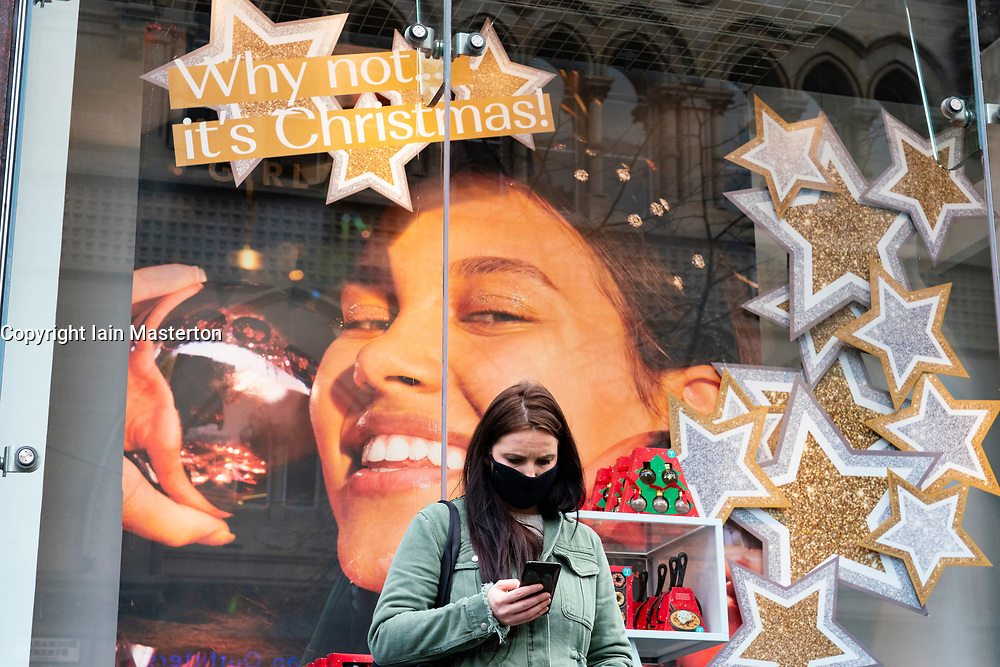 Glasgow,Scotland, UK. 2 November 2020. As Scotland enters new Coronavirus lockdown regulations the central belt and Glasgow are placed in Level 3 . Members of the public are seen out on the streets of central Glasgow for shopping and work. Pictured; Christmas window display in New Look store.  Iain Masterton/Alamy Live News