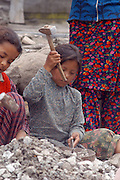 India, vashisht, Kullu District, Himachal Pradesh, Northern India, young children of about 8 years old at work at a stone quarry, breaking rocks into gravel with a hammer