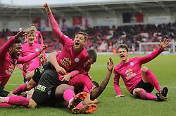 Peterborough United celebrate after Ricardo Almeida Santos (floored) scores the winning goal - Mandatory byline: Joe Dent/JMP - 19/03/2016 - FOOTBALL - The Keepmoat Stadium - Doncaster, England - Doncaster Rovers v Peterborough United - Sky Bet League One