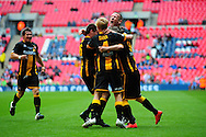 GOAL! Christopher Swailes  of Morpeth Town AFC is mobbed by his teammates after scoring to make it 1-1 during the FA Vase match between Hereford FC and Morpeth Town at Wembley Stadium, London, England on 22 May 2016. Photo by Mike Sheridan.