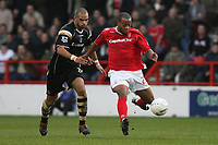 Photo: Pete Lorence.<br />Nottingham Forest v Charlton Athletic. The FA Cup. 06/01/2007.<br />Jonathan Fortune and Junior Agogo in action.