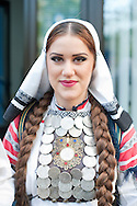 Young woman in traditional local folk costume, a member of the KUD Veselin Maslesa Folklore Ensemble, Banja Luka, Bosnia and Herzegovina (11 April 2014). KUD Veselin Maslesa is the leading folklore ensemble in Bosnia and Hercegovina, with the country's largest collection of authentic folk costumes, and has won numerous awards. © Rudolf Abraham