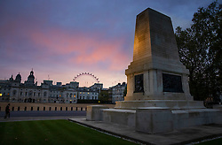 © Licensed to London News Pictures. 12/10/2020. London, UK. The sunrise illuminates clouds over Whitehall. Later Prime Minister Boris Johnson will outline his plans for a three-tier system of local lockdowns to try and stop the rise of Covid-19 infections. Photo credit: Peter Macdiarmid/LNP