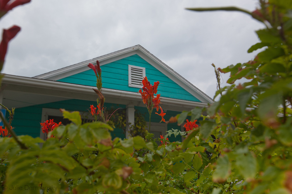 House with tropical colors on Elbow Cay, one of the Abaco Islands in the Bahamas.