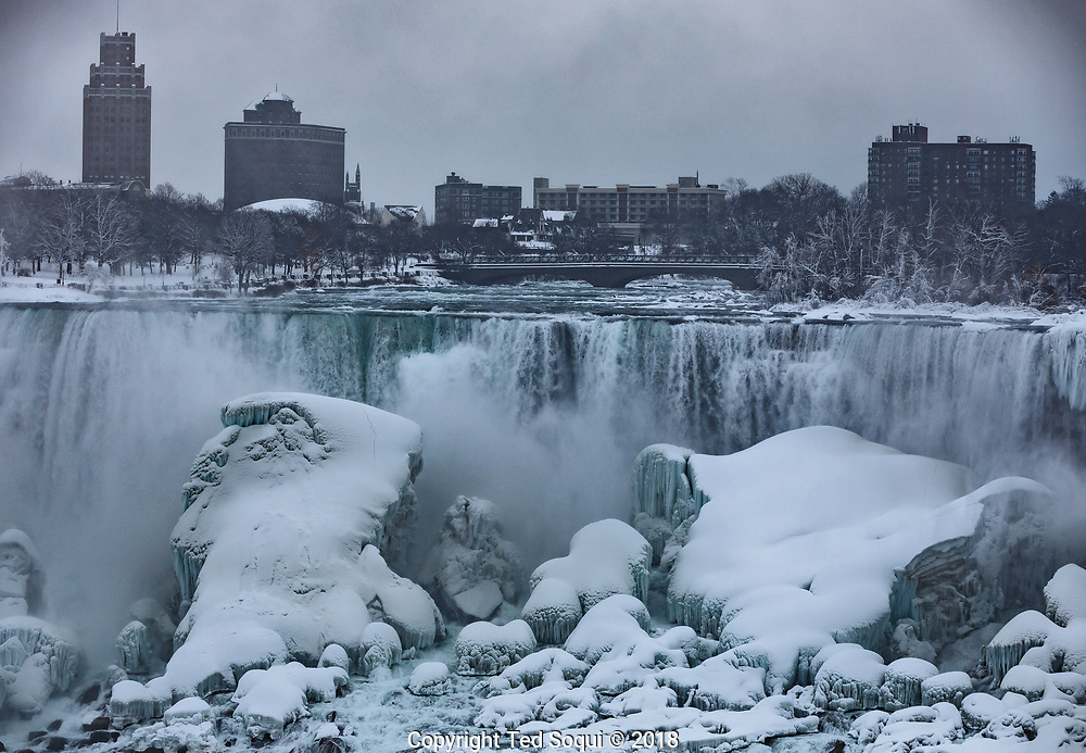 Winter time in the Niagara Falls area. Ice gathers on the rocks and walls from the fall's spray.