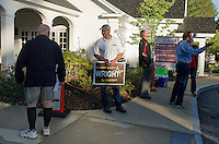 Jim McIntyre showing his support of Wright for Sheriff welcomes voters to the Gilford Community Center on Tuesday morning.  (Karen Bobotas/for the Laconia Daily Sun)