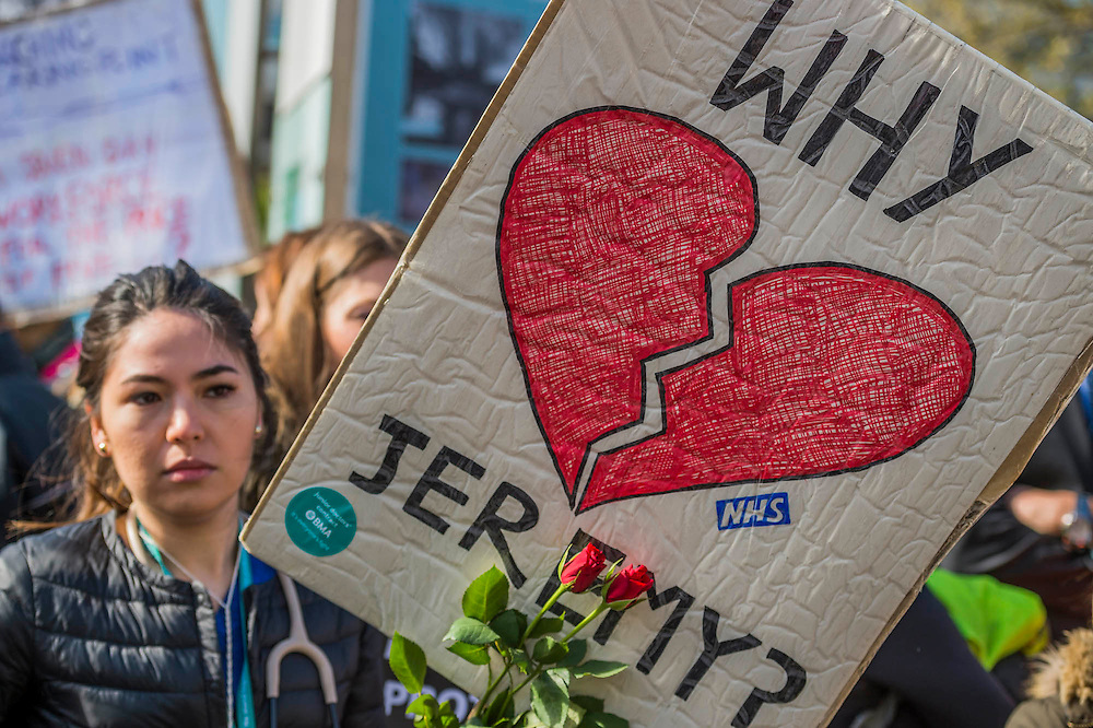 Dr Anjani Knobel with roses given by a passer by - The picket line at St Thomas' Hospital. Junior Doctors stage a 7 day all out strike action, this time imncluding accident and emergency coverage. They are striking against the new contracts due to be imposed by the Governemnt and health minister Jeremy Hunt. They are supported by the British Medical Association.