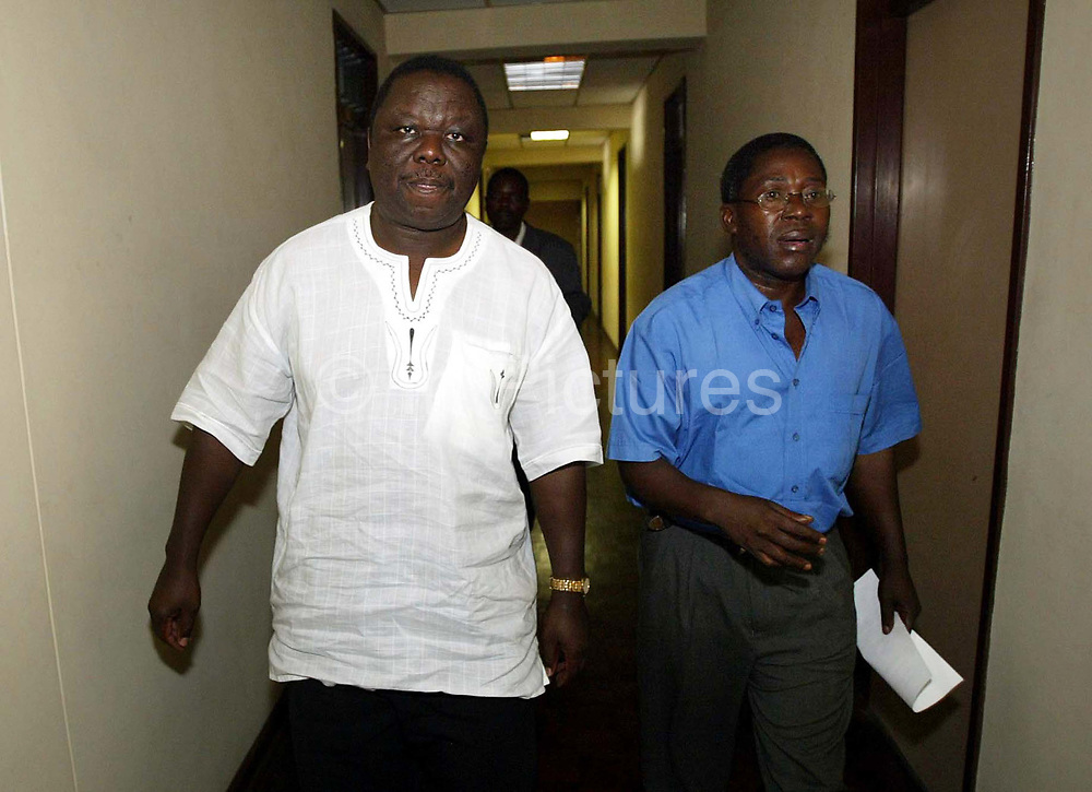 Morgan Tsvangirai (L) leader of the MDC in Zimbabwe, arrives to chair an emergency NEC meeting at the MDC HQ Harare.