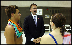 """File Photo - Olympic diver Tom Daley has revealed he is in a relationship with a man.<br /> <br /> Britain's Prime Minister David Cameron and Mayor of London Boris Johnson together with Jeremy Hunt Secretary of State for Culture, Olympics, Media and Sport Talk to British Diver Tom Daley and members of the British Diving team during a visit to the Olympic Aquatic Centre on January 9, 2012 in London, England. Cameron held a cabinet meeting at the 2012 Olympic Games site and highlighted the 'lasting legacy' the London 2012 Olympics will leave, as the London Olympics countdown enters its final 200 days, Monday January 9, 2012. Photo By Andrew Parsons/ i-Images<br /> <br /> Olympic diver Tom Daley has revealed he is in a relationship with a man.<br /> <br /> In a YouTube broadcast, the 19-year-old London 2012 bronze medallist said: """"In spring this year my life changed massively when I met someone, and they make me feel so happy, so safe and everything just feels great.<br /> <br /> """"That someone is a guy.""""<br /> Photo Andrew Parsons/i-Images"""