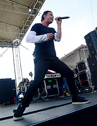 March 20, 2018 - Fontana, CA, USA - Musician -  GAVIN ROSSDALE, lead singer and guitar for the band BUSH performing live on stage before the start of the NASCAR Auto Club 400, Auto Club Speedway, Fontana, California, USA, March 19, 2018.  ..Credit Image  cr  Scott Mitchell/ZUMA Press (Credit Image: © Scott Mitchell via ZUMA Wire)