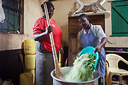 Kitchen staff prepare food for all the pupils at Kibera School, Nairobi. The school consists of 6 teachers with approximately 60 children in each class.  Undugu Society of Kenya (USK) are an NGO who run various programmes to help the school and pupils including a lunchtime feeding program.