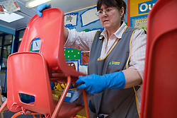 School domestic stacking plastic chairs in primary school classroom,