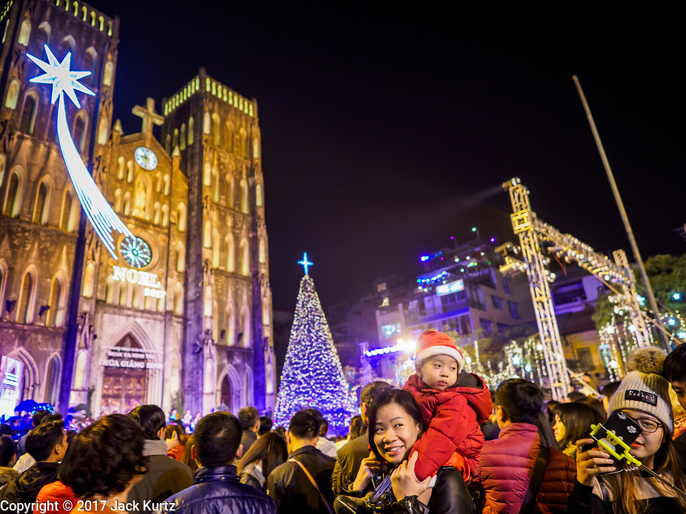 22 DECEMBER 2017 - HANOI, VIETNAM: People at the Christmas show at St. Joseph's Cathedral in Hanoi. There are about 5.6 million Catholics in Vietnam. The Cathedral was one of the first structures built by the French during the colonial era and was opened in 1886. It's one of the most popular tourist attractions in Hanoi.    PHOTO BY JACK KURTZ