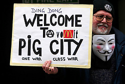© Licensed to London News Pictures 17/04/2013.A protester holds up a sign outside St Paul's Cathedral in central London, where Margaret Thatcher's funeral was being held. .London, UK.Photo credit: Anna Branthwaite/LNP