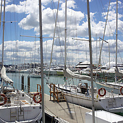 Moored yachts in Viaduct Basin. Auckland, New Zealand, .Located in the heart of Auckland City, Viaduct Basin and Harbour is a first class residential, commercial and entertainment precinct..The marina caters to commercial vessels, pleasure craft and super yachts with 150 marina berths ranging in size up to 60 metres..Viaduct Basin hosts many fabulous events including the past America's Cup defences, Louis Vuitton Regattas, the Volvo Round the World Race stopover, Auckland International Boatshow and New Zealand Fashion Week..Visitors can explore New Zealand's rich maritime history at Voyager Maritime Museum, cruise the harbour on a charter yacht, view the yachts berthed in the harbour and enjoy the world class hospitality at the many bars and restaurants that line the waters edge..New Zealand's largest marine service precinct, Westhaven, lies a short walk to the west.. Auckland, New Zealand. 31st October  2010. Photo Tim Clayton..