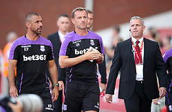 Stoke City Manager Gary Rowett (centre) and First Team Coach Kevin Phillips (left) during a pre season friendly match at The Bet365 Stadium, Stoke.