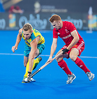 BHUBANESWAR, INDIA - Jack Waller (Eng) with Daniel Beale (Aus)    , England v Australia for the bronze medal during the Odisha World Cup Hockey for men  in the Kalinga Stadion.   COPYRIGHT KOEN SUYK