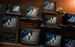 A television store airs one of Amr Khaled's weekly programs, Cairo, Egypt, Dec. 27, 2005.  The Islamic televangelist, had previously been asked to leave Egypt as his revival gained strength. As a result he started preaching on several television shows, turning him into an international celebrity. Some religious scholars complain that Khaled has not been properly trained in Islam to command such a following.