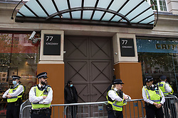 London, UK. 28th May, 2021. Metropolitan Police officers guard the UK headquarters of Elbit Systems, an Israel-based company developing technologies used for military applications including drones, precision guidance, surveillance and intruder-detection systems, in advance of a protest by activists from Palestine Action. The activists had organised the protest against Elbit's presence in the UK and against British arms sales to and support for Israel.