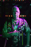 Freeport, New York, USA. 10th Sept. 2014. FRANK NEAL, of Hempstead, an American Legion Riders Post #1488 member, holds his hand over his heart while 'Gold Bless America' is sung, at night on board the boat Miss Freeport V, which sailed from the Woodcleft Canal of the Freeport Nautical Mile after a dockside remembrance ceremony in honor of victims of the terrorist attacks of September 11 2001. American Legion, Patriot Guard Riders, and Captain Frank Rizzo hosted the ceremonies on the eve of the 13th anniversary of the 9/11 attacks.