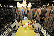 TIANJIN, CHINA - SEPTEMBER 06: (CHINA OUT) <br /> <br /> Jail-themed Restaurant <br /> <br /> Do they serve porridge? China opens first ever prison-themed restaurant complete with dungeon and water torture devices<br /> <br /> Fancy a bit of Kung Pao in the clink? Tianjin city in China has opened its first ever prison-themed restaurant and has had customers queuing to experience life as an inmate.<br /> Diners have their meals in separate dining rooms - or cells - which are made from iron caging. Each cell varies in size depending on the number of customers per party.<br /> The city's first Prison of Fire restaurant is designed to look exactly like a genuine Chinese jail, complete with dungeons and confinement rooms.<br /> Each dining room is made to look different, with ordinary cells, single cells and a water dungeon with an arresting view of water torture devices.<br /> And it's not just the customers who are treated like prisoners. Even the acts who perform there are trapped in a birdcage-like structure which can barely fit in a keyboard and guitar, let alone a four-piece band.<br /> Adventurous diners are served their dinner through a door hatch but, unlike real prisoners, get to enjoy their meals on proper cutlery and crockery.<br /> The restaurant owner has said he wants diners to 'cherish their freedom and stay away from crimes <br /> ©Exclusivepix