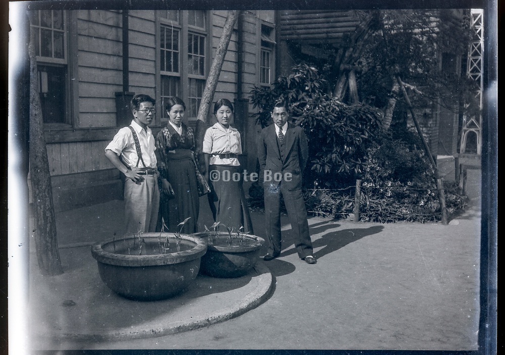 people posing in a garden setting Japan ca 1940s
