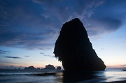Sunset at Phra Nang Bay, Railay. This pure white sand beach is surrounded by spectacular limestone cliffs. Central in the bay stands Phra Nang's distinctive rock, looming over the bay dramatically.
