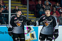 KELOWNA, BC - JANUARY 26: Michal Kvasnica #38 and Kaden Kohle #17 of the Vancouver Giants fist bump to celebrate a goal against the Kelowna Rockets at Prospera Place on January 26, 2020 in Kelowna, Canada. (Photo by Marissa Baecker/Shoot the Breeze)