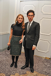 EDWARD TANG and YUKI OSHIMA-WILPON at the 4th Fortune Forum Summit held at The Dorchester Hotel, Park Lane, London on 4th December 2012.