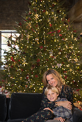 mother and son together by a Christmas tree