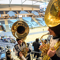 """012214  Adron Gardner/Independent<br /> <br /> Window Rock High School 11th-grade student Jordan Weiland, right, shoulders a tuba before opening ceremonies for the Bee Hółdzil """"Stronghold"""" Fighting Scouts Event Center in Fort Defiance Wednesday."""