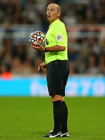 NEWCASTLE UPON TYNE, ENGLAND - SEPTEMBER 17: the referee, Mike Dean, holds the match ball during the Premier League match between Newcastle United and Leeds United at St. James Park on September 17, 2021 in Newcastle upon Tyne, England. (Photo by MB Media)