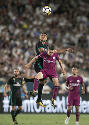 July 26, 2017 - Los Angeles, California, U.S - Casemiro #14 of Real Madrid goes for a high ball battling Manchester City defender during their International Champions Cup game at the Los Angeles memorial Coliseum in Los Angeles, California on Wednesday July 26, 2017. Manchester City defeats Real Madrid, 4-1. (Credit Image: © Prensa Internacional via ZUMA Wire)