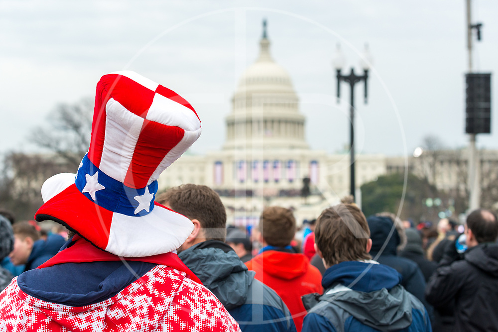 Washington DC, United States - A stars and stripes, Cat in the Hat-type hat adorns an attendee at the inauguration of Donald J. Trump.