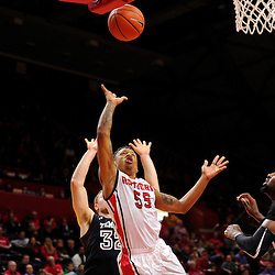 D'Von Campbell #55 of the Rutgers Scarlet Knights lays up a basket over Anthony Lee #3 of the Temple Owls during the second half of Rutgers men's basketball vs Temple Owls in American Athletic Conference play on Jan. 1, 2014 at Rutgers Louis Brown Athletic Center in Piscataway, New Jersey.