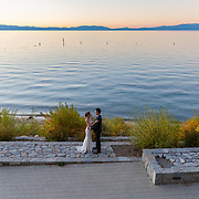 Calm and tranquil sunset post ceremony moment at Regan Beach, California in South Lake Tahoe with the bride and groom.