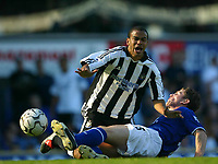 Photo Aidan Ellis.<br />Everton v Newcastle United.<br />FA Barclaycard Premiership.<br />13/09/2003.<br />Newcastle's Keiron Dyer is brought down by Everton's Gary Naysmith for a penalty which Naysmith was sent off for