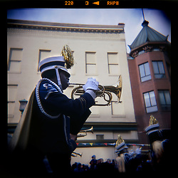 A high school marching band trumpeter marches down F Street at the Chinese New Year Parade held annually in Washington, DC's Chinatown...