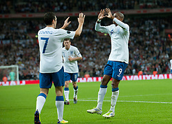 06.09.2011, Wembley Stadium, London, GBR, UEFA EURO 2012, Qualifikation, England vs Wales, im Bild England's Ashley Young celebrates with Stewart Downing after scoring his teams first goal during the UEFA Euro 2012 Qualifying Group G match against Wales at Wembley Stadium on 6/9/2011. EXPA Pictures © 2011, PhotoCredit: EXPA/ Propaganda Photo/ Gareth Davies +++++ ATTENTION - OUT OF ENGLAND/GBR+++++