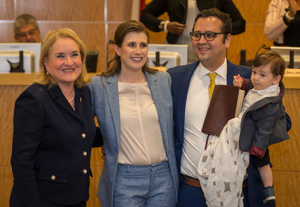 Holly Maria Flynn Vilaseca Ocampo poses for a photograph with her husband, son, and Sylvia Garcia after taking the oath of office to become Houston ISD Trustee for District VI, January 12, 2017.
