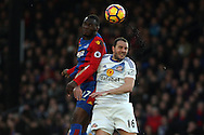 Christian Benteke of Crystal Palace (L) jumps for a header with John O'Shea of Sunderland (R). Premier League match, Crystal Palace v Sunderland at Selhurst Park in London on Saturday 4th February 2017. pic by Steffan Bowen, Andrew Orchard sports photography.