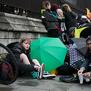 Memebers of the Extinction Rebellion Youth group has locked themselves to the fence of Parliament demanding climate change action, May 3rd 2019, Central London, United Kingdom. The youth stayed for 3 hours and no arrests were made. The environmental protest group Extinction Rebellion has called for civil disobedience and peaceful protest to force the British government to take drastic action on climate change. The group wants the government to tell the truth and admit that the impact of climate change is much more severe than they say and that action to mitigate catastrophic climate change is urgent.