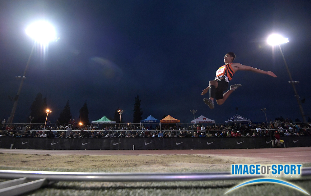 Apr 7, 2018; Arcadia, CA, USA; Kevin Maria (2648) of San Jacinto competes in the long jump during the 51st Arcadia Invitational at Arcadia High.