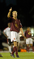 Photo: Leigh Quinnell.<br /> Arsenal v Fulham. The Barclays Premiership.<br /> 24/08/2005. Dennis Bergkamp thanks the lines man for getting hiom booked.