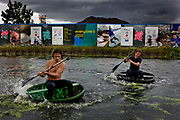 coracle regatta, on the canal in front of the site of the London Olympic stadium, Hackney, London