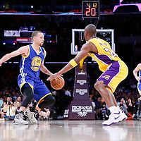 11 April 2014: Los Angeles Lakers guard Jodie Meeks (20) defends on Golden State Warriors guard Stephen Curry (30) during the Golden State Warriors 112-95 victory over the Los Angeles Lakers at the Staples Center, Los Angeles, California, USA.