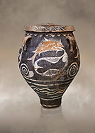 Minoan Kamares Ware jar with natural decorations of fish in a net, Phaistos 1900-1700 BC; Heraklion Archaeological  Museum.<br /> <br /> This pot is one of the earliest known examples of the shift of Minoan art towards depicting the natural world .<br /> <br /> If you prefer to buy from our ALAMY PHOTO LIBRARY  Collection visit : https://www.alamy.com/portfolio/paul-williams-funkystock/minoan-art-artefacts.html . Type -   Heraklion   - into the LOWER SEARCH WITHIN GALLERY box. Refine search by adding background colour, place, museum etc<br /> <br /> Visit our MINOAN ART PHOTO COLLECTIONS for more photos to download  as wall art prints https://funkystock.photoshelter.com/gallery-collection/Ancient-Minoans-Art-Artefacts-Antiquities-Historic-Places-Pictures-Images-of/C0000ricT2SU_M9w