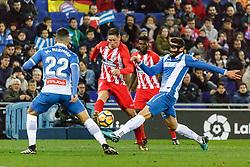 BARCELONA, Dec. 23, 2017  Atletico de Madrid's Fernando Torres (2nd L) vies with RCD Espanyol's David Lopez (1st R) during a Spanish league match between RCD Espanyol and Atletico de Madrid in Barcelona, Spain, on Dec. 22, 2017. RCD Espanyol won 1-0. (Credit Image: © Joan Gosa/Xinhua via ZUMA Wire)