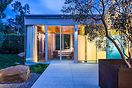 """CL20 Residence by Shubin+Donaldson Architects.<br /> <br /> How do you add on to a suburban home with minimal cost but maximum design impact?<br /> <br /> This is a question that most American homeowners face at some point, especially owners of post-war built tract and """"ranch style"""" homes. Our answer is the following:<br /> <br /> 1. Pre-fab or modularize the construction as much as possible<br /> 2. Minimize impact on existing home and yard as much as possible<br /> 3. Maximize floor plan and wall adaptability<br /> 4. Maximize energy and resource efficiency<br /> 5. Use reclaimed construction materials where possible<br /> <br /> The 14 ft. x 34 ft.CL20 minimally connects to the existing house with a glass box connecting space. It deploys """"off the shelf"""" structural steel moment frames that bolt to a standard concrete slab on grade. These 4 frames support the flat roof thus providing all the vertical and lateral support necessary for the entire structure. This allows floor plan flexibility and eliminates exterior shear walls. The CL20 exterior walls are custom installed dual pane insulated glass and proprietary sliding doors. This transparent glass box minimizes visual impact on the yard while providing maximum interior day lighting.<br /> <br /> Resource Efficiency:<br /> <br /> The flat roof provides an excellent platform for a photovoltaic array to service the CL20 and existing residence. The interior walls and ceiling are reclaimed clear Douglas fir.<br /> <br /> All lighting is LED, and heating/cooling is provided by a high efficiency Mitsubishi split system. <br /> <br /> Text ©Shubin+Donaldson Architects, Inc.<br /> <br /> http://shubinanddonaldson.com/projects/cedar-lane/"""